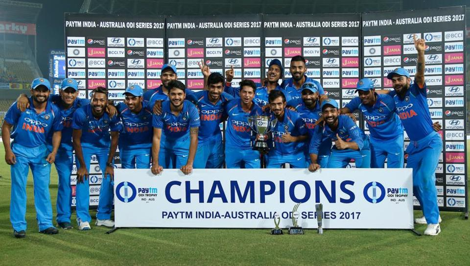 The Indian team posing after defeating Australia in the 5th One-Day International at the Vidarbha Cricket Association Stadium in Nagpur on Sunday.