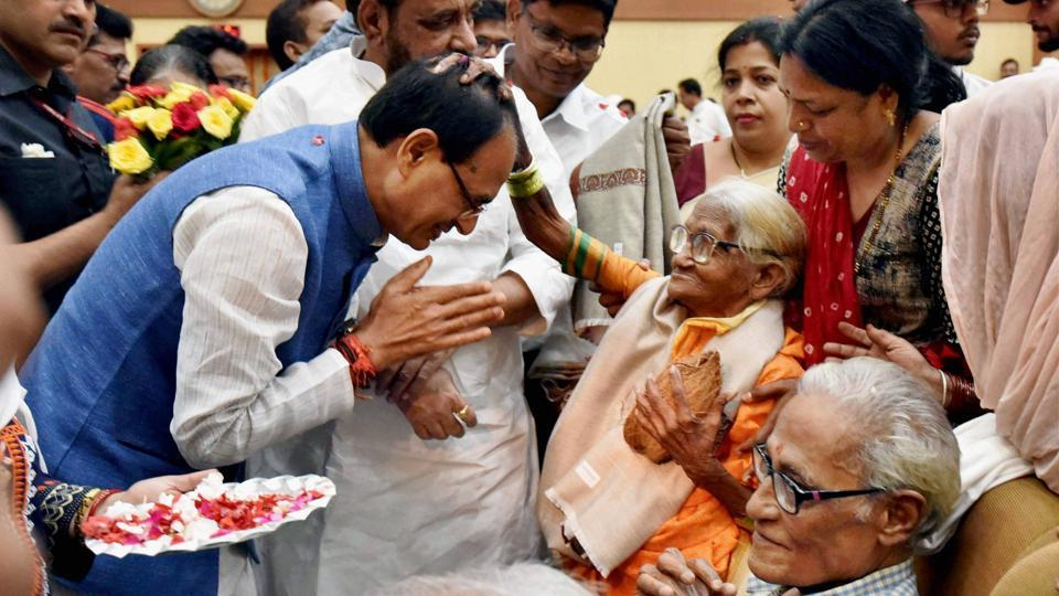Madhya Pradesh chief minister Shivraj Singh Chouhan felicitating senior citizens at a programme to mark the International Day of Older Persons, in Bhopal on Sunday.