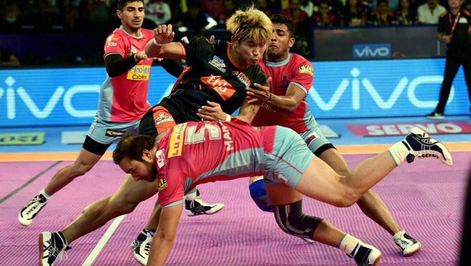 Players of Jaipur Pink Panthers (pink jersey) and Bengal Warriors (black and orange) in action during a Pro Kabaddi League match at Jawaharlal Nehru Indoor Stadium in Chennai on Sunday.