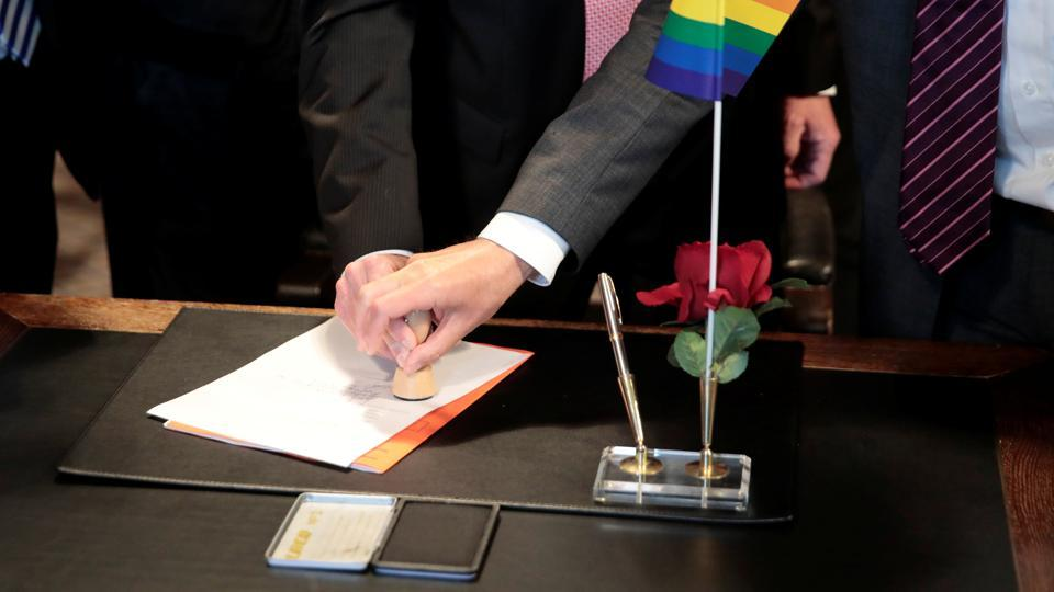 Same-sex couple Karl Kreil and Bodo Mende get married at a registry office, becoming Germany's first married gay couple after German parliament approved marriage equality in a historic vote this past summer, in Berlin, Germany October 1.