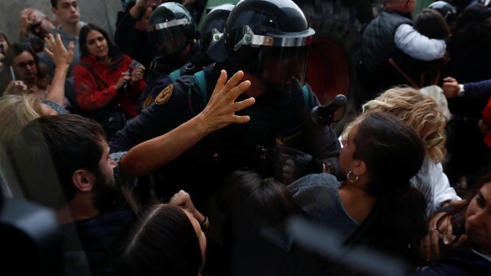 Scuffles break out as Spanish Civil Guard officers force their way through a crowd and into a polling station for the banned independence referendum where Catalan President Carles Puigdemont was supposed to vote in Sant Julia de Ramis, Spain October 1, 2017.