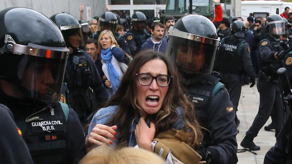 People clash with Spanish Guardia Civil guards outside a polling station in Sant Julia de Ramis, where Catalan president was supposed to vote, on October 1, 2017, on the day of a referendum on independence for Catalonia banned by Madrid.
