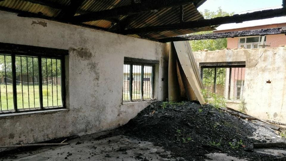 In August, the Jammu and Kashmir high court directed the government to complete the process of providing funds for reconstruction and repairing of the damaged schools within four weeks. The psychological wounds haven't healed either. 'It is inhuman to have students study in the same building where they are constantly reminded of the fact that an attempt was made to burn it. The least the government can do is to repair it,' said a government school teacher in Batengoo, Anantnag district. (Neelam Pandey / HTPhoto)