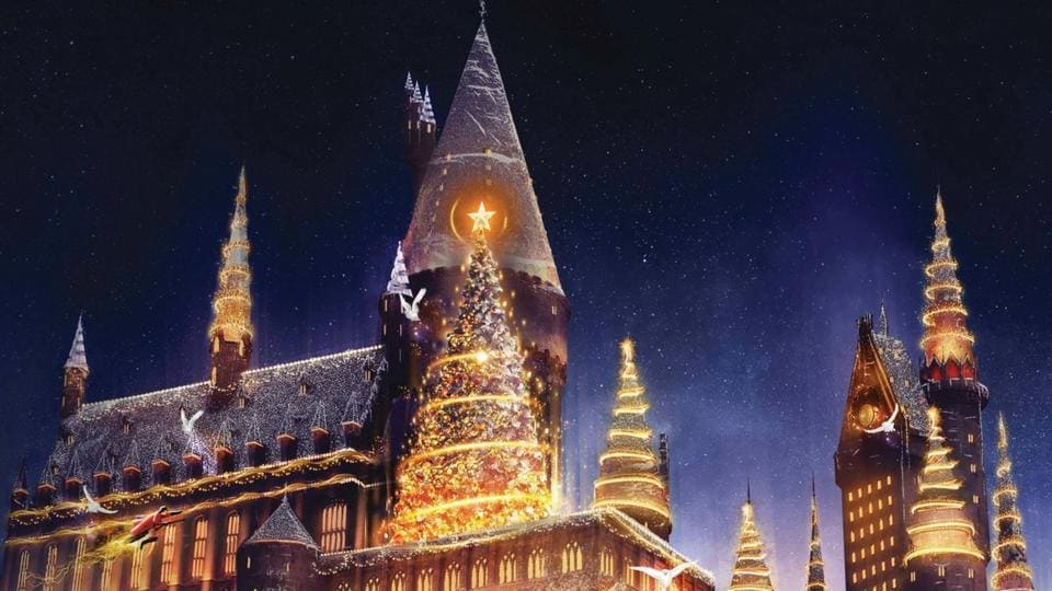 A festive light projection featuring animated characters dancing to music will illuminate Hogwarts castle.