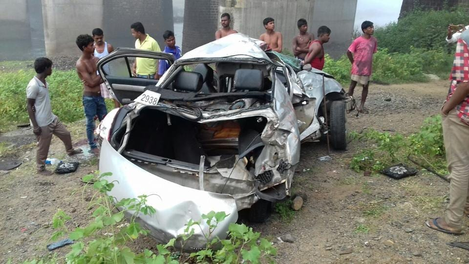 The mangled remains of the car which fell from the bridge into the Surya river