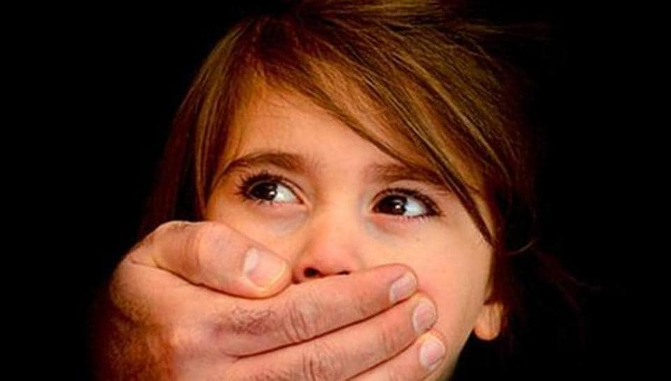 Local residents led by the girl's father nabbed the co-accused even as he was sexually assaulting the unconscious child on a neighbourhood river bank.