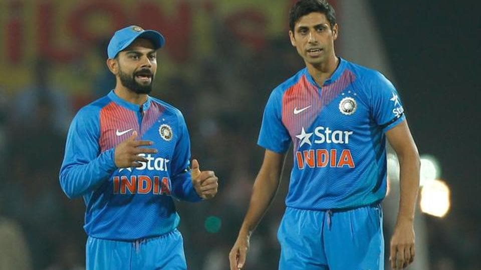 67fd1d7587d Virat Kohli talks with Ashish Nehra during the 2nd T20 between India and  England at the Vidarbha Cricket Association stadium on January 29