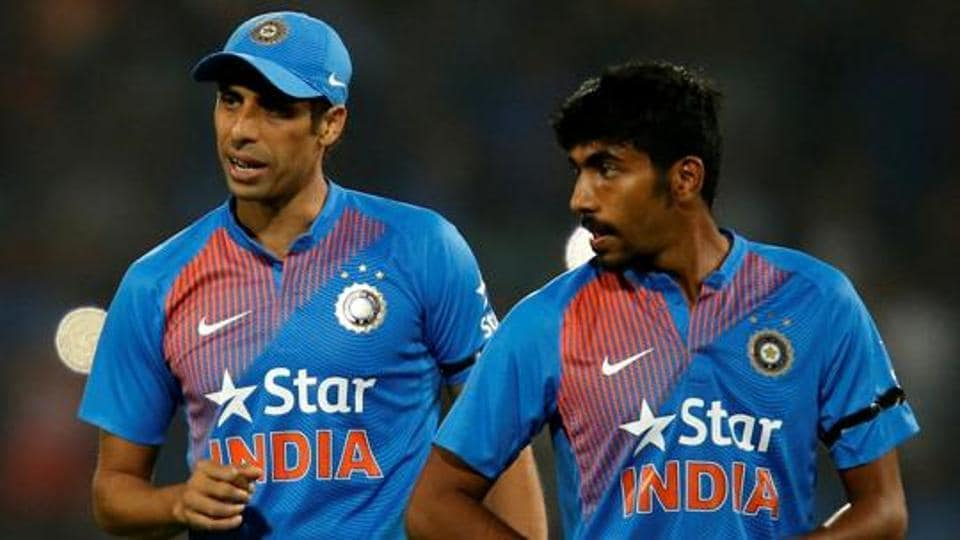 Ashish Nehra (Left) and Jasprit Bumrah will lead India's pace attack during the three-match T20 series vs Australia at home. The first match will be played in Ranchi from October 7.