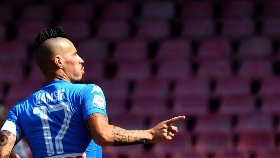 Napoli midfielder Marek Hamsik celebrates after scoring during the Italian Serie A football match vs Cagliari.