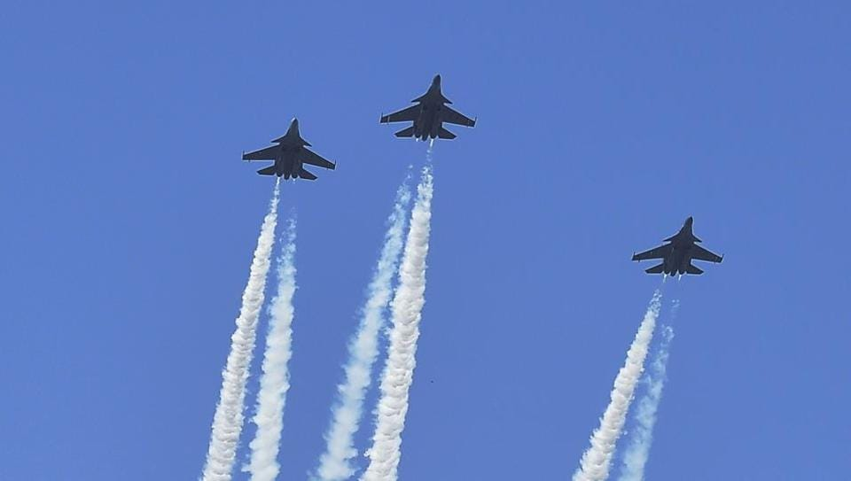 Indian Air Force fighter jets carry out fly-past in a 'missing man' formation over the Delhi Cantonment.