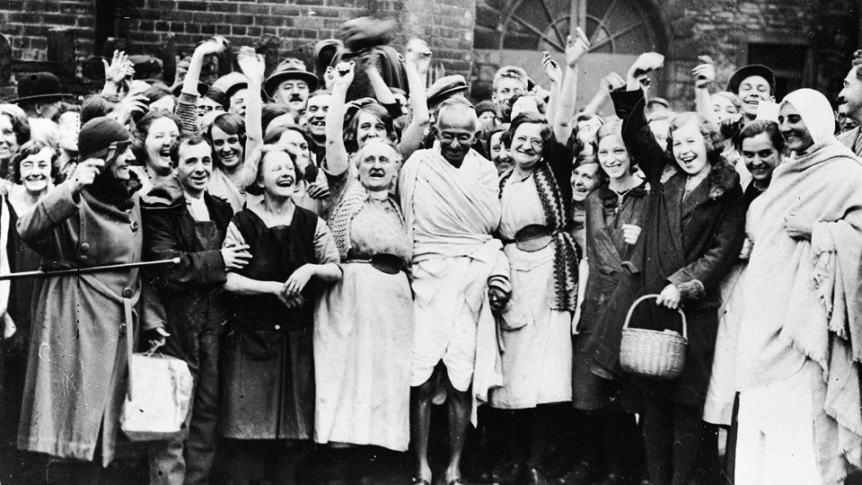 In 1931, during a visit to Darwen, Lancashire, Mahatma Gandhi was greeted by a group of women textile workers. Gandhi was famous for his propagation of Khadi, an Indian textile. (Keystone / Getty Images)