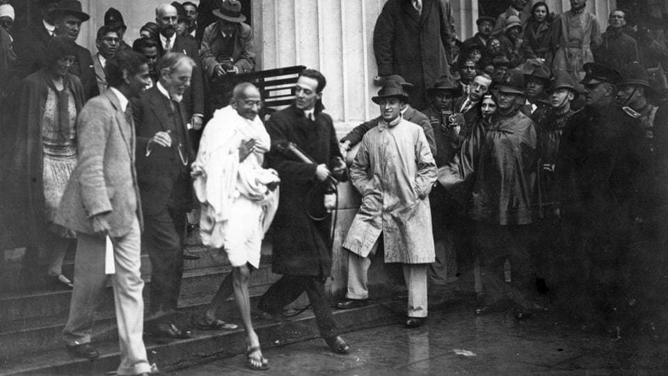 Gandhi is seen leaving Friends' Meeting House, Euston Road, London, after attending the Round Table Conference on Indian constitutional reforms.  (Douglas Miller / Getty Images)