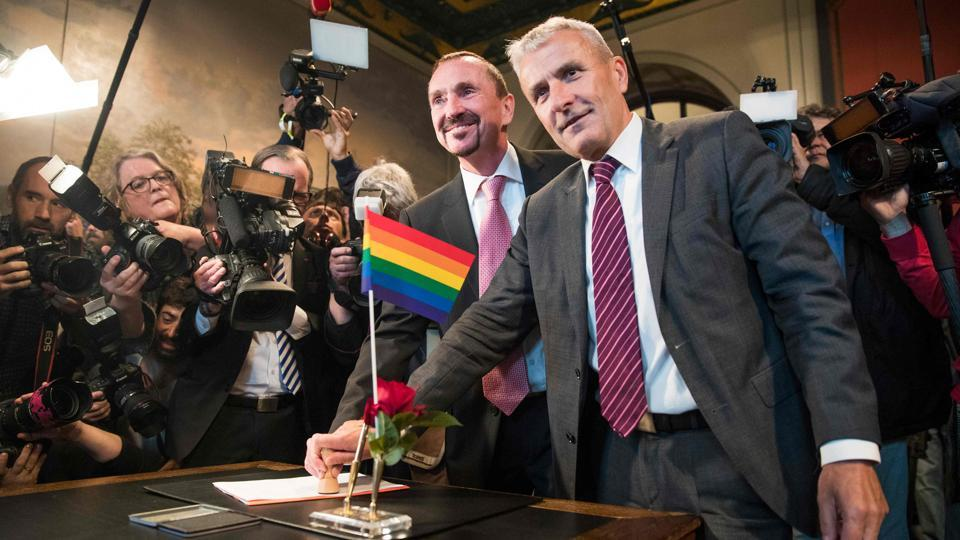 Same-sex couples married in Germany for the first time on Sunday, with several dozen couples tying the knot at civil registry offices that opened specially to mark the coming into force of a law passed by parliament in June. Among them were Karl Kreile (L) 59, and Bodo Mende (R), 60, who became Germany's first married gay couple, exchanging vows at the town hall in Schoeneberg after 38 years together. (Odd Andersen / AFP)