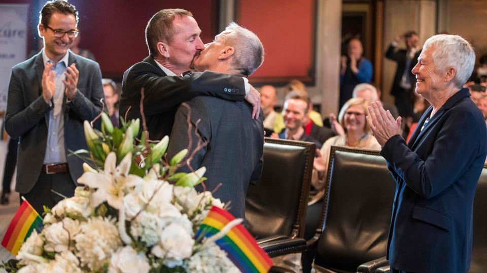 Bode Mende (2nd R) and Karl Kreile (2nd L) kiss watched by their witnesses Angelika Daser (R), Joerg Steinert (L) and guests after becoming Germany's first married gay couple. Mende called for Germany and the EU to do more to promote gay rights across Europe. 'We don't need to look far, just to the neighbour countries where the situation is more disturbing,' he said, an apparent reference to Poland and others where same-sex marriage is still forbidden. (Odd Andersen / AFP)