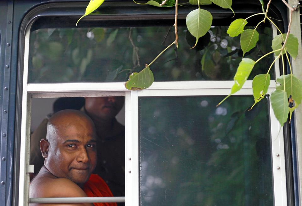 Sri Lanka's Buddhist monk Akmeemana Dayarathana, who led hardline nationalists in an unruly protest against Rohingya Muslim asylum seekers last week, looks out from a prison bus in Mount Lavinia, Sri Lanka on October 2.