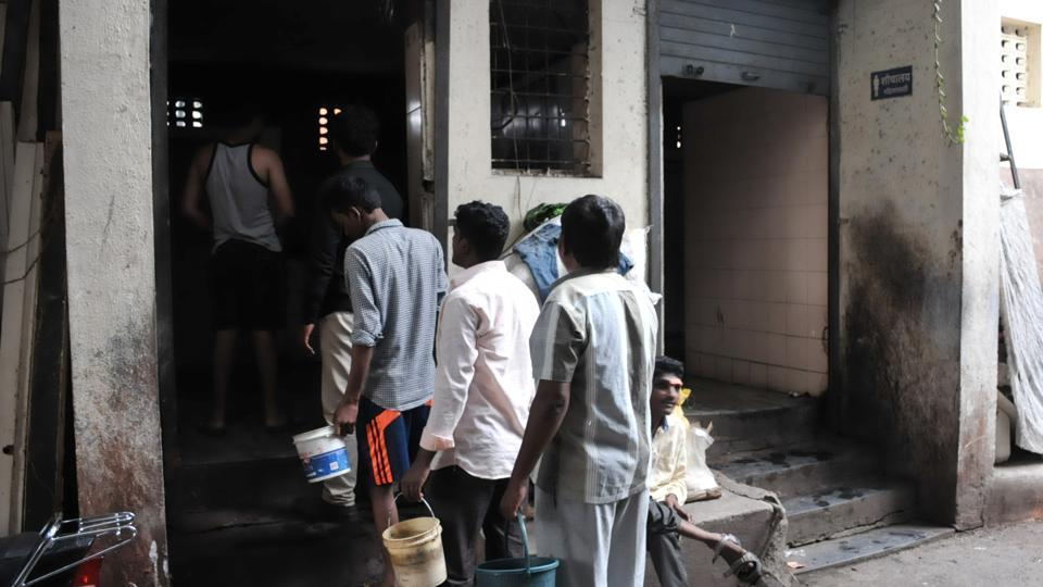 Citizens standing in a queue outside a toilet at Janwadi, Gokhale nagar in Pune on Monday.
