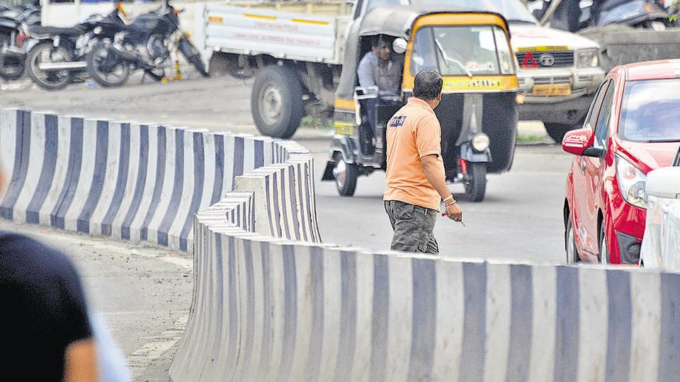 Pedestrians cross the accident-prone spot located at Baner road in Pune.