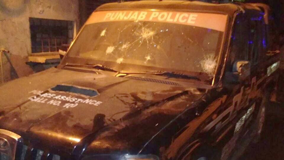 The police vehicle that was damaged by agitators at Basti Jodhewal area in Ludhiana.