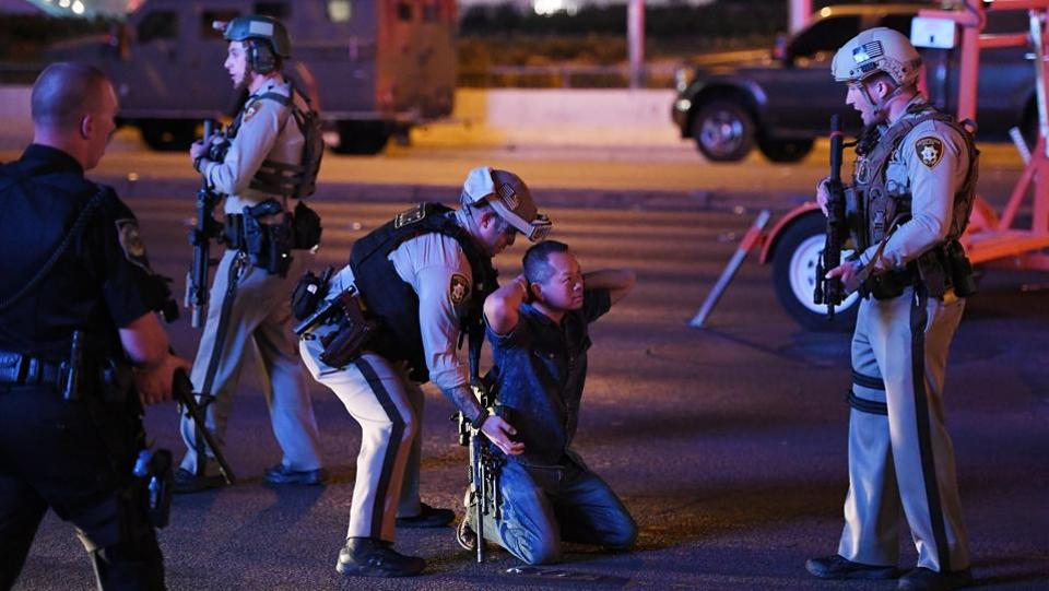 A gunman killed over 50 people and wounded more than 200 at a country music festival on the Las Vegas Strip on Sunday, raining down rapid fire from the 32nd floor of a hotel for several minutes before he was shot dead by police. The death toll would make the attack the deadliest mass shooting in US history, eclipsing last year's massacre of 49 people at an Orlando night club. (Ethan Miller / AFP)