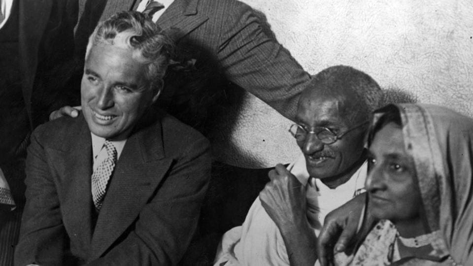 Mahatma Gandhi and his wife Kasturba Gandhi meet Hollywood actor Charlie Chaplin at the home of Dr. Katral in Canning Town, east London.  (London Express / Getty Images)