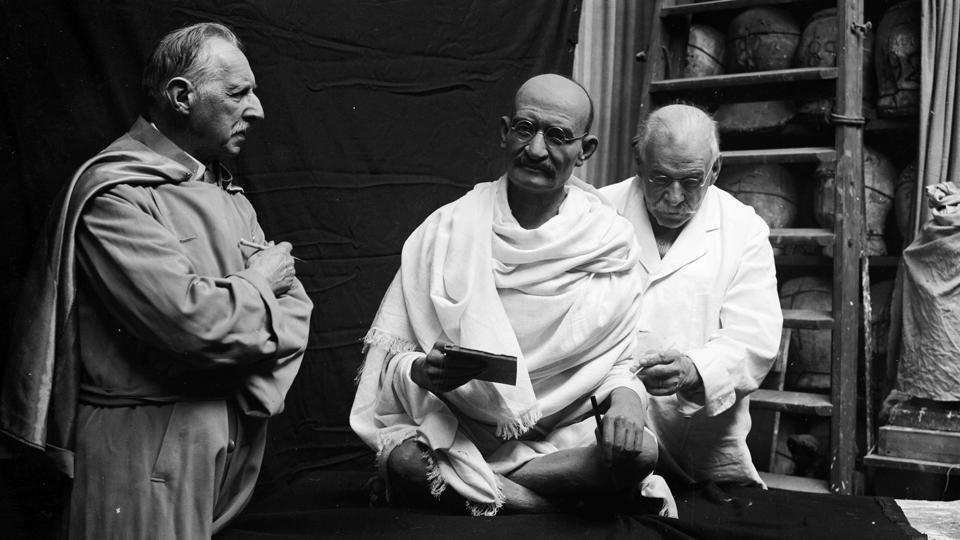 John Tussaud, son of Marie Tussaud working on a waxwork of Mahatma Gandhi for Madame Tussaud's, 1931. (Fox Photos / Getty Images)