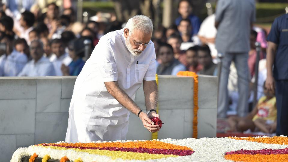 Prime Minister Narendra Modi pays tribute to Mahatma Gandhi on his 148th birth anniversary at Rajghat in New Delhi on Monday.