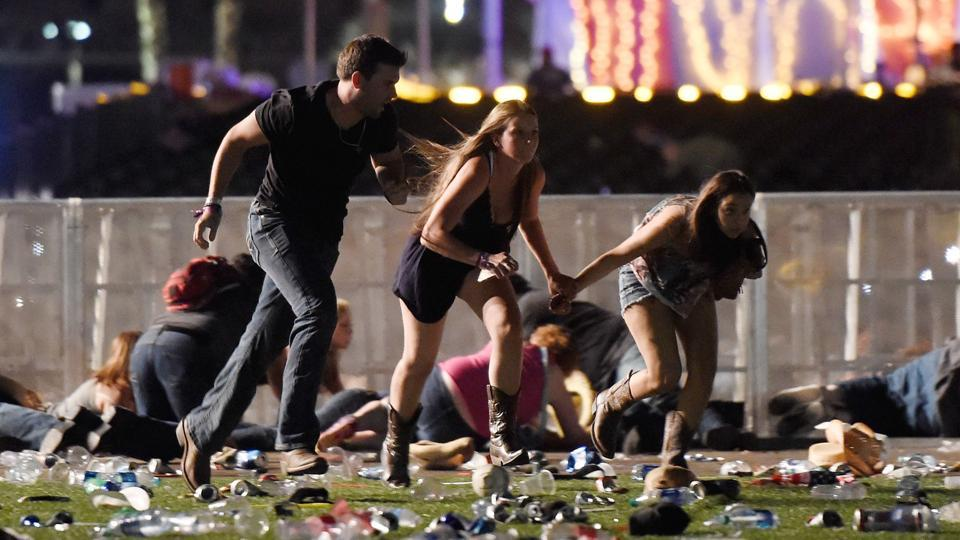 Thousands of panicked people fled the scene, in some cases trampling one another as law enforcement officers scrambled to locate and kill the gunman.Shocked concertgoers, some with blood on their clothes, wandered the streets after the attack. (David Becker / AFP)