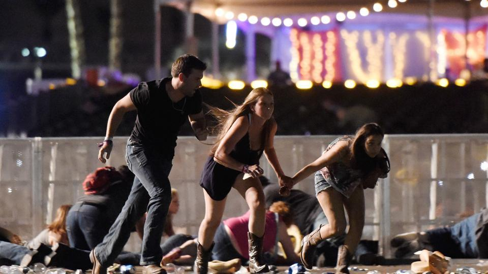 People run from the Route 91 Harvest country music festival after gunfire was hear on October 1, 2017.
