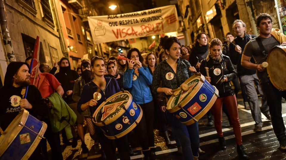 Pro independence supporters play their drums with banner reading, ''Long life working class'', while they walk through the old city in support of the Catalonia's secession referendum, in Pamplona, northern Spain, Sunday, Oct. 1, 2017.