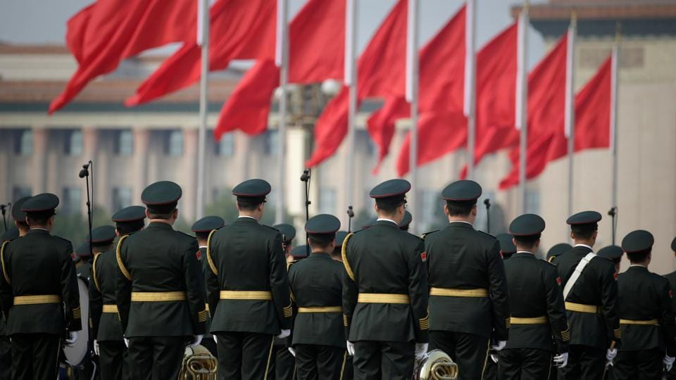 A military band waits to attend a commemoration ceremony at Tiananmen Square to mark the 68th anniversary of the founding of the People's Republic of China, in Beijing. (Jason Lee / REUTERS)