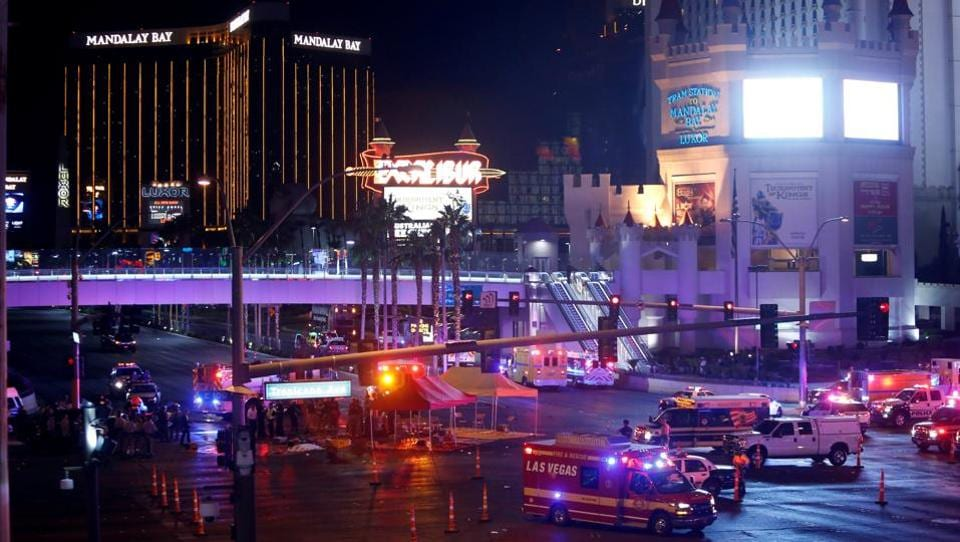 Las Vegas Metro Police and medical workers stage in the intersection of Tropicana Avenue and Las Vegas Boulevard South after a mass shooting at a music festival . U.S. President Donald Trump offered his condolences to the victims via a post on Twitter early Monday. (Steve Marcus  / REUTERS)