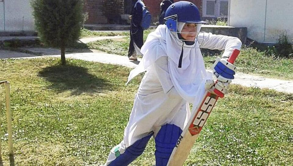 Well defended! A woman cricketer in Baramulla defying social restrictions in her passion for the sport.