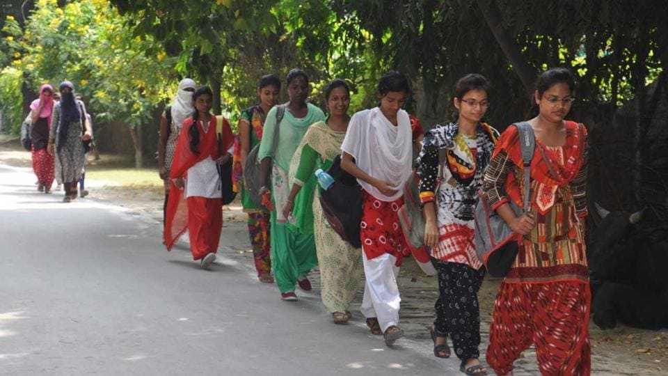 Students return to the Banaras Hindu University after it reopened on Tuesday.