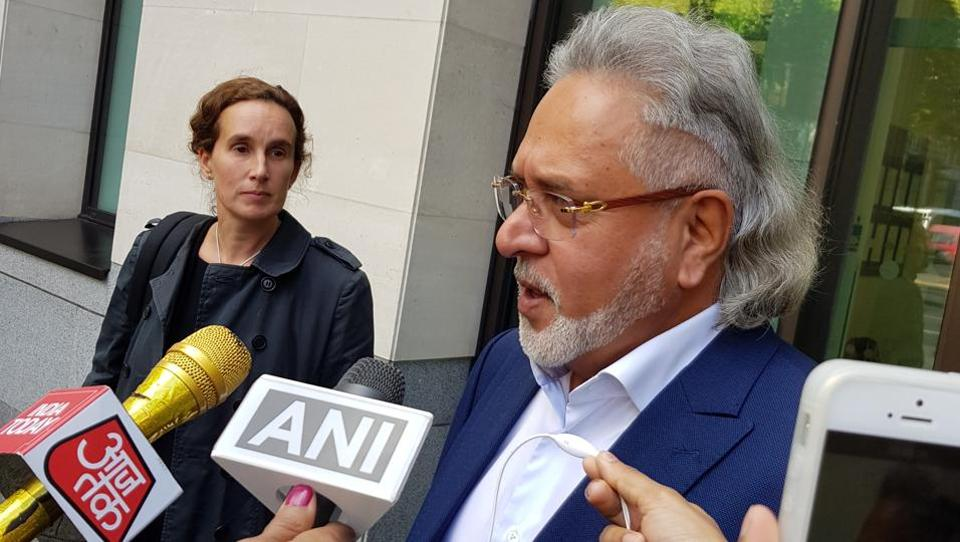 Vijay Mallya talks to reporters as he leaves the Westminster Magistrates' Court in London on October 3, 2017.