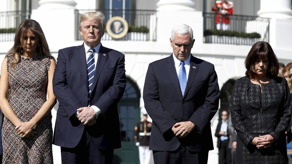 President Donald Trump and first lady Melania Trump stood with vice president Mike Pence and his wife Karen during a moment of silence to remember the victims of the mass shooting in Las Vegas, on the South Lawn of the White House in Washington. (AP)