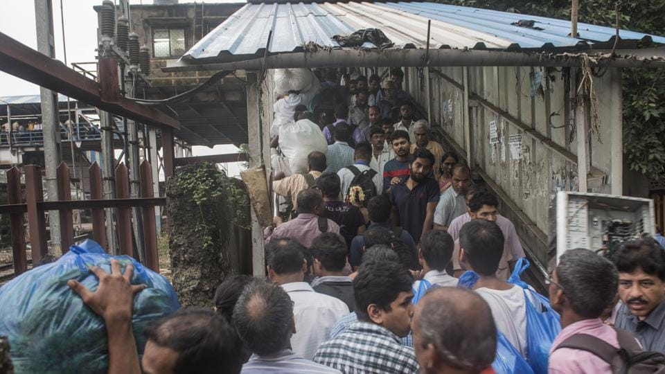 Police officers try to control the crowd after the stampede at Elphinstone Road station in Mumbai on September 29.
