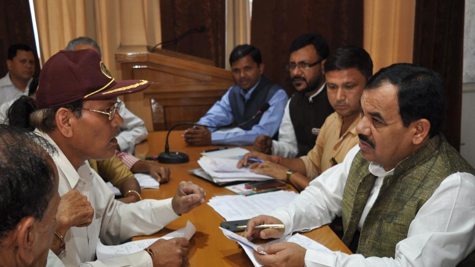 Forest minister Harak Singh Rawat listens to public grievances at the Janta Darshan at the BJP office in Dehradun on Tuesday.
