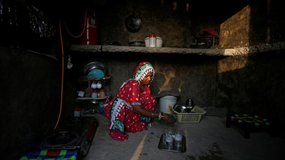 One of the first women to be trained successfully, Gulaban 25, is seen in the kitchen of her home in Islamkot, Tharparkar, Pakistan.  (Akhtar Soomro / REUTERS)