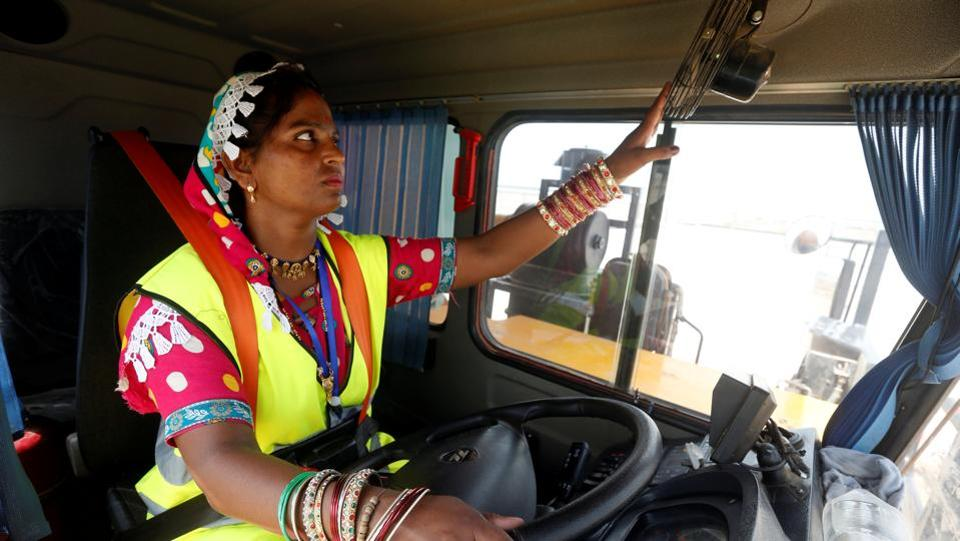 Gulaban, 25, adjusts a fan before driving a 60-tonne truck during a training session of the 'Female Dump Truck Driver Programme' in Islamkot, Pakistan. She is among 30 women being trained by the Sindh Engro Coal Mining Company (SECMC), which will need 300-400 trucks once they burrow deep enough to reach the coal in the Thar desert. (Akhtar Soomro / REUTERS)