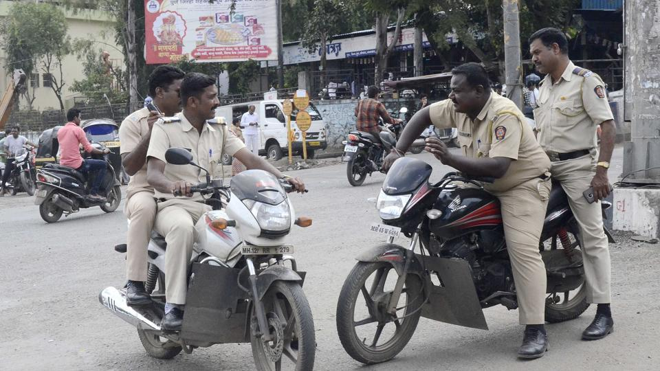Police without helmets near Rajiv Gandhi Zoological park in Pune on September 7, 2017.