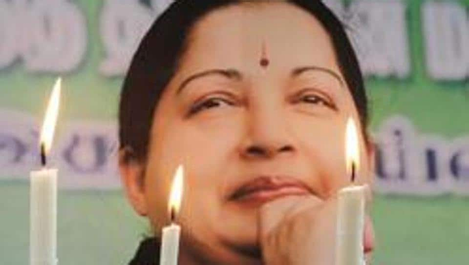 Supporters of Jayalalithaa Jayaraman, light candles as they pay tribute after her death, in Allahabad on December 6, 2016.