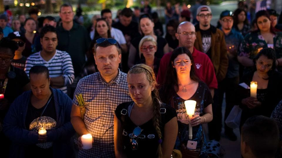 Mourners attend a candlelight vigil at the corner of Sahara Avenue and Las Vegas Boulevard for the victims of Sunday night's mass shooting, in what transpired to be one of the deadliest mass shooting in American history killing atleast 59 and injuring over 500 people.  (Drew Angerer / AFP)