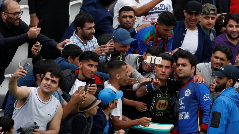 Rashid Khan poses for photographs with Afghan fans at Lord's. He has been the poster boy of cricket in Afghanistan.