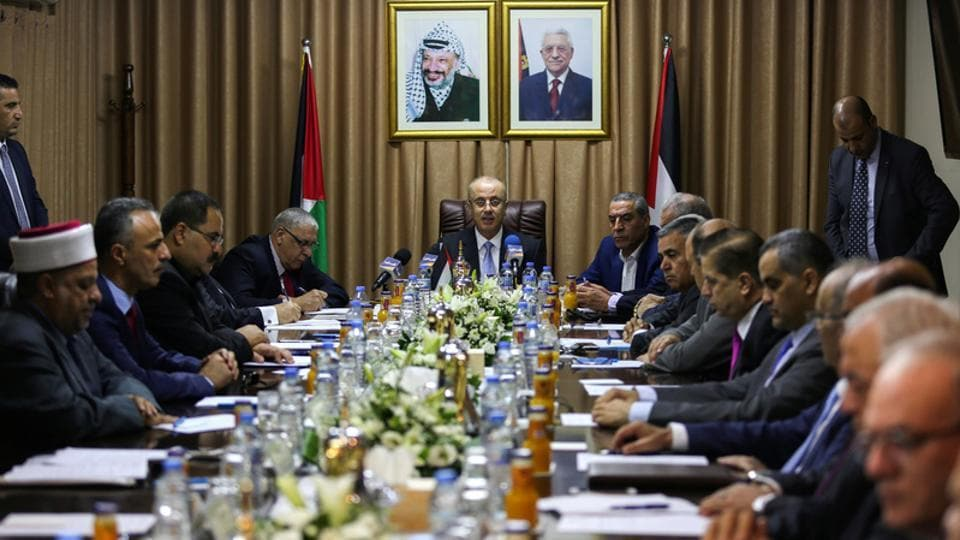 Palestinian Prime Minister Rami Hamdallah (centre) chairs a cabinet meeting in Gaza City on October 3, 2017.