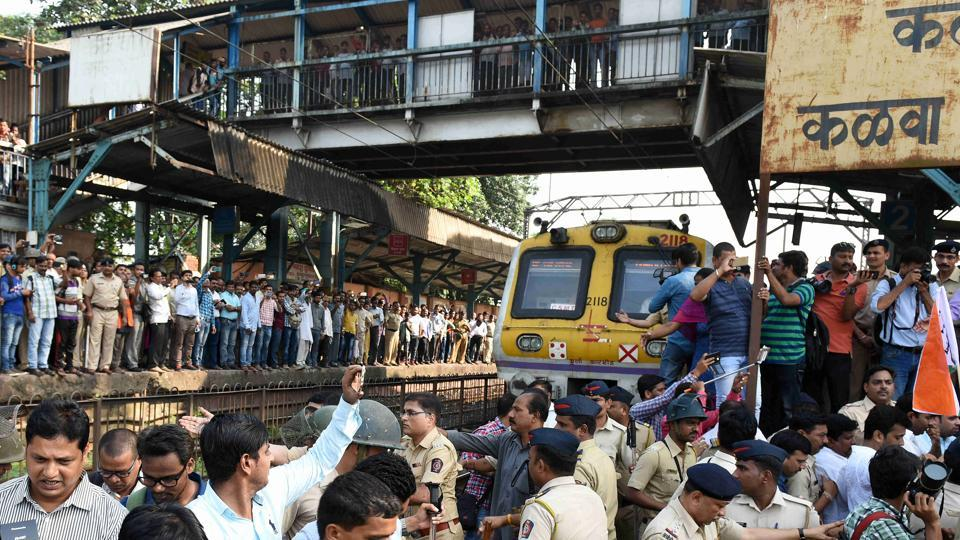 Nationalist Congress Party workers staged a two-minute rail roko at the crowded Kalwa railway station on Tuesday.