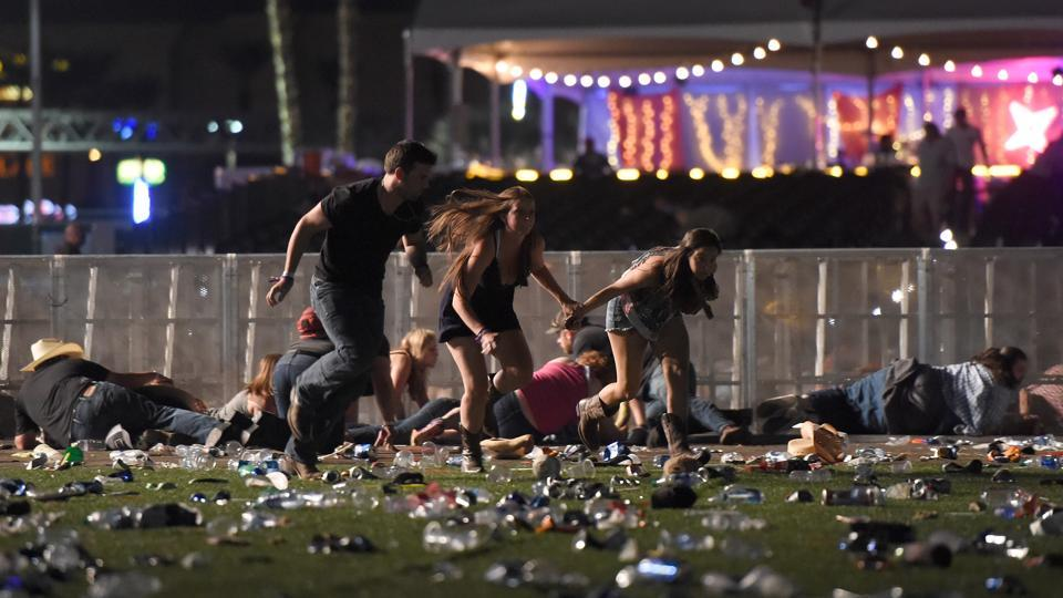 People run from the Route 91 Harvest country music festival after apparent gun fire was heard on October 1, 2017 in Las Vegas, Nevada.