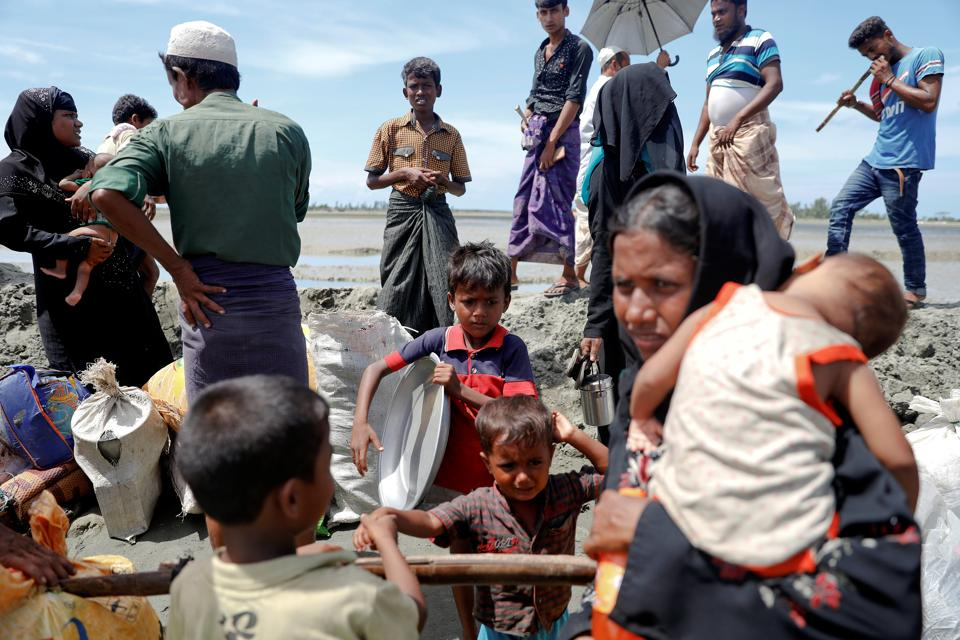 Rohingya refugees who arrived from Myanmar make their way to a relief centre in Teknaf, near Cox's Bazar in Bangladesh.