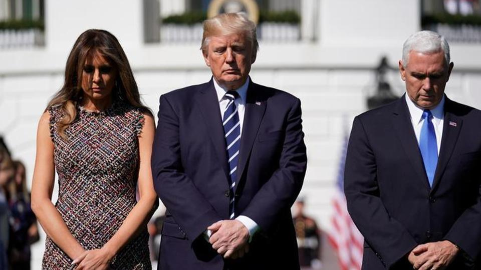US President Donald Trump stands with first lady Melania Trump and Vice President Mike Pence during a moment of silence in the wake of the the mass shooting in Las Vegas at the White House in Washington, US, October 2, 2017.