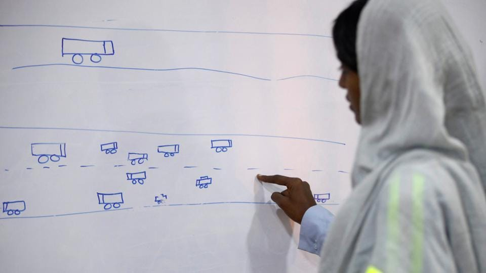 The training program for women is elaborate as they are taught to familiarize themselves with the path of the trucks that they will eventually drive among other technical details. (Akhtar Soomro / REUTERS)