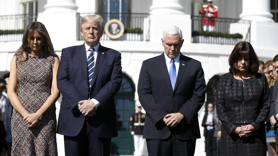 President Donald Trump and first lady Melania Trump stand with vice president Mike Pence and his wife Karen during a moment of silence to remember the victims of the mass shooting in Las Vegas, on the South Lawn of the White House in Washington, Monday, October 2, 2017.